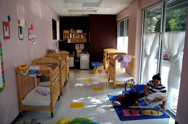 Sunny bright infant room at The Nest Academy Learning Preschool