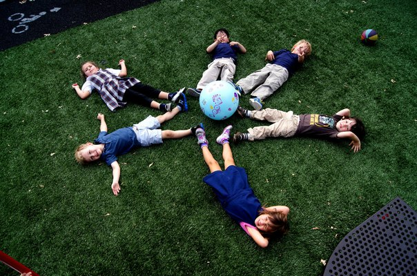 kids are playing with a ball
